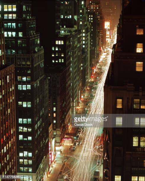 1970s NIGHT SHOT LOOKING NORTH ON 7TH AVENUE FROM STATLER HILTON ROOF NOW THE HOTEL PENNSYLVANIA