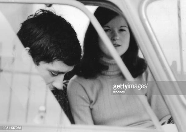 1970s outdoor portrait of young friends having fun in the countryside in black and white. fiat 500 - 20th century style stock pictures, royalty-free photos & images