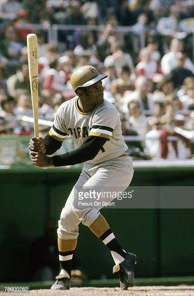 Outfielder Roberto Clemente Pittsburgh Pirates is at the plate ready to hit during a MLB baseball game circa early 1970s Clemente played for the...