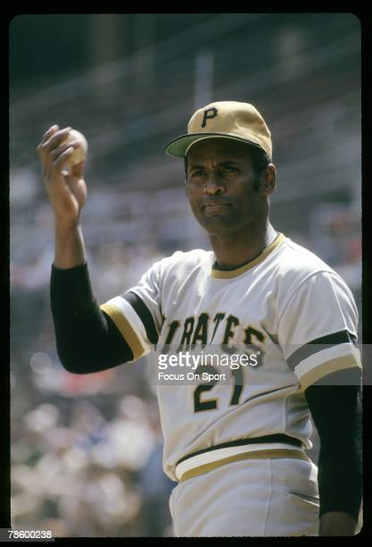 Outfielder Roberto Clemente Pittsburgh Pirates warms up before a MLB baseball game circa early 1970s Clemente played for the Pirates from 195572