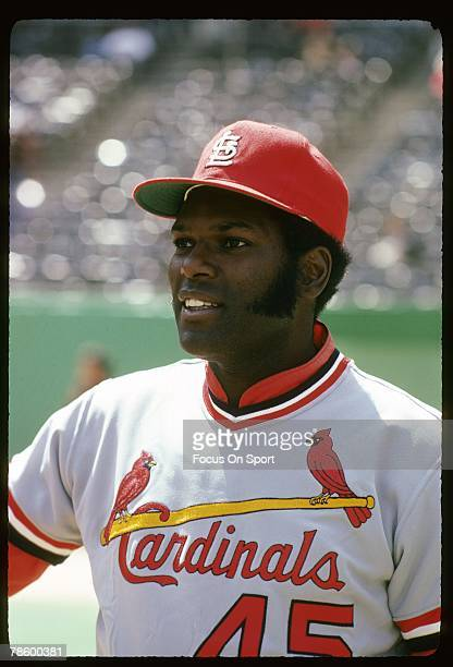 Pitcher Bob Gibson of the St Louis Cardinals on the field smiling before a circa 1970s Major League Baseball game Gibson played for the Cardinals...
