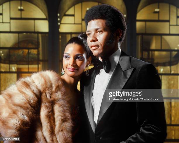 1970s PORTRAIT AFRICAN AMERICAN COUPLE MAN TUXEDO WOMAN FUR COAT OUT ON THE TOWN
