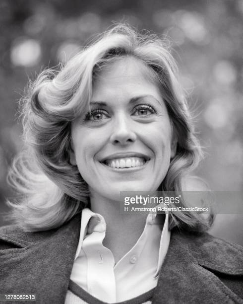 1970s Portrait Smiling Woman Feathered Haircut Wearing Blouse With Leather Jacket Outdoor Looking At Camera