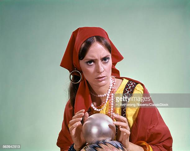 1970s PSYCHIC CRYSTAL BALL FORTUNE TELLER LOOKING AT CAMERA