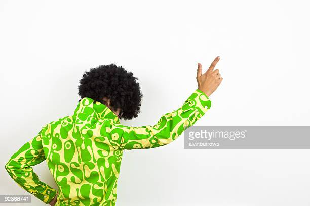 1970s styled disco dude points upward.