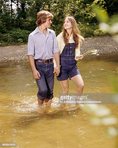 1970s TEEN COUPLE WALKING...