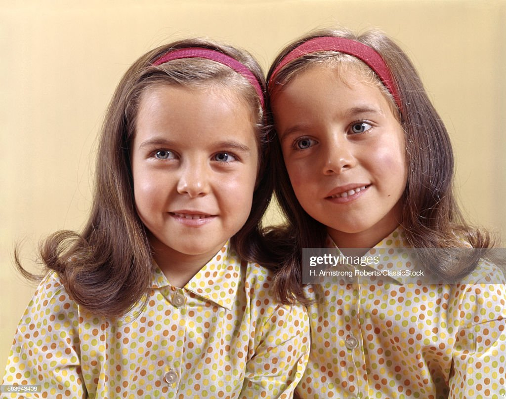 1970 1970s TWINS SISTERS... : Stock Photo
