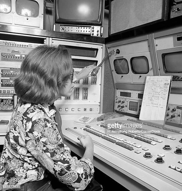 1970s WOMAN AT SMALL TV...