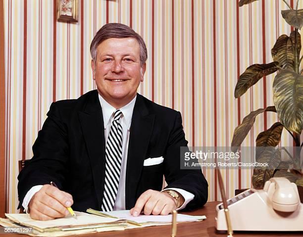 1970sMILING BUSINESSMAN...