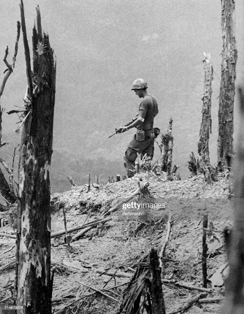 For his dramatic photographs of the Vietnam War, United Press International staff photographer David Kennerly won the 1972 Pulitzer Prize for feature photography. This 1971 photo from Kennerly's award-winning portfolio shows an American GI, his weapon drawn, cautiously moving over a devastated hill near Firebase Gladiator. BPA2#5288