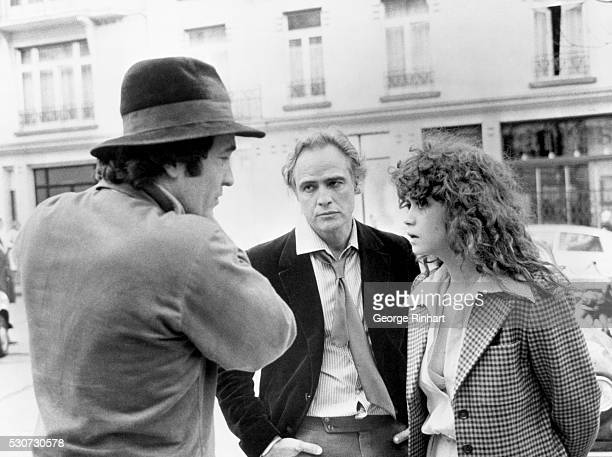 1973Paris France Marlon Brando with director Bernardo Bertolucci and costar Maria Schneider during filming of the picture The Last Tango in Paris
