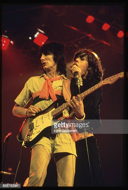 1975Singer and guitarist Mick Jagger and Ron Wood of the rock roll band the Rolling Stones performing next to each other during a concert