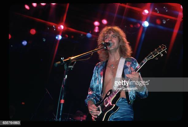 1977Rock and roll musician Peter Frampton is shown playing and singing in concert
