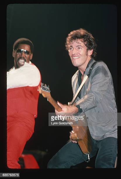 1978Photo shows rock and roll musician Bruce Springsteen and Clarence Clemmons on stage playing in concert Springsteen is shown playing guitar