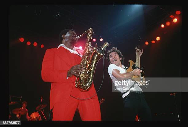 1978Photo shows rock and roll musician Bruce Springsteen and saxonphonist Clarence Clemmons playing in concert on stage In the background can be seen...