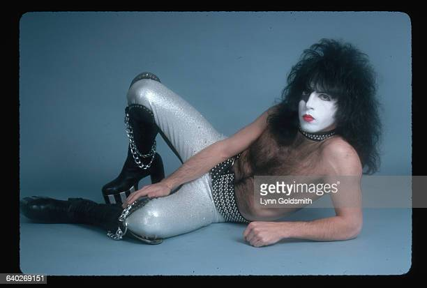 Photo shows Paul Stanley lead singer and guitarist with the rock and roll group KISS posed lying down in this studio portrait He is shown shirtless...