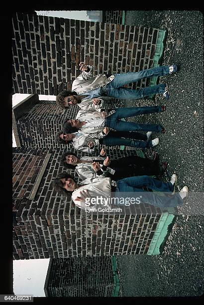 1979The rock and roll group Blue Oyster Cult is shown standing on the roof of a building gesturing towards the camera