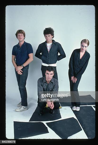 1980Photo shows the rock group The Talking Heads posed in a studio Left to right in back Chris Frantz Jerry Harrison and Tina Weymouth Kneeling in...