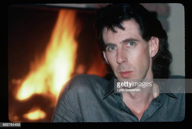 Ric Ocasek, lead singer and songwriter with the rock and roll group The Cars, is shown in a head and shoulders close-up. Behind him can be seen a...
