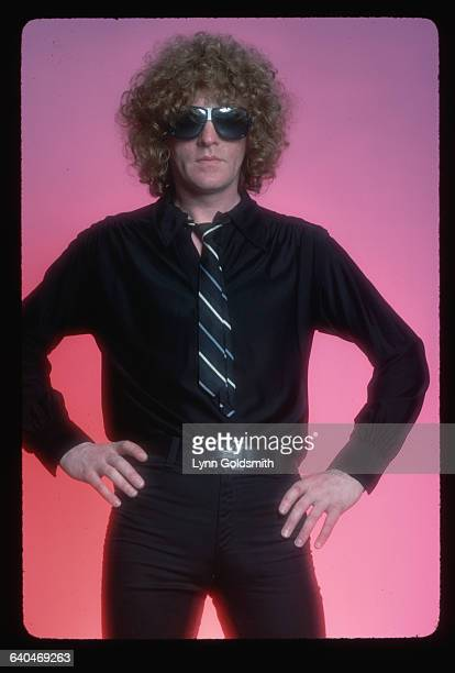 1980Rock and roll singer/songwriter Ian Hunter is shown in a studio portrait wearing black pants shirt and tie He holds his hands on his hips in this...
