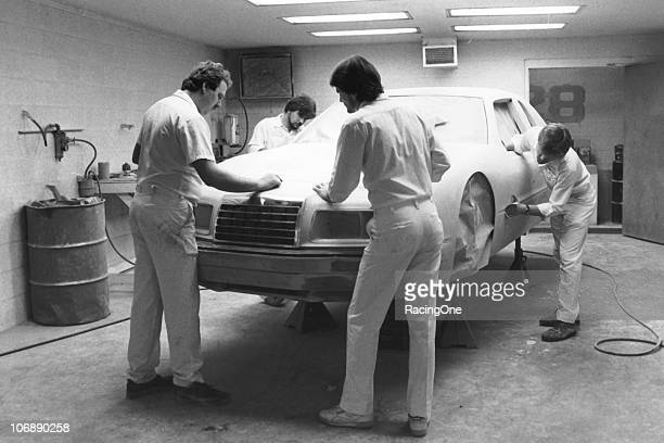 A crew at the Harry Ranier Racing shop preps one of their NASCAR Cup Fords in the mid1980s for a final paint job before itÕs taken to the track and...