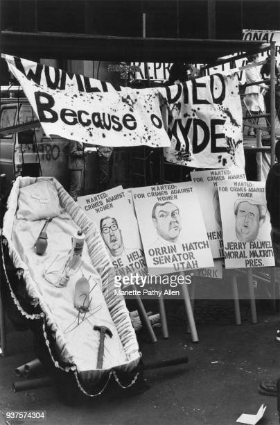 An open coffin with the tools of abortion is propped up next to proabortion signs saying 'Women Died Because of Hyde' and 'Wanted for crimes against...