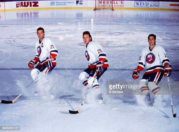 Brent Sutter Pat Flatley and Pat Lafontaine of the New York Islanders