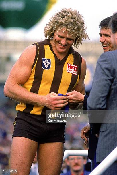 Dermott Brereton of the Hawthorn Hawks recieves his medal after a AFL Grand Final match held at the Melbourne Cricket Ground Melbourne Australia