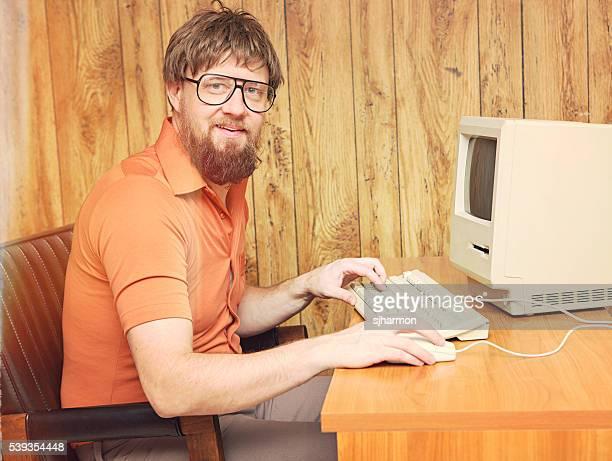 1980s dorky man at retro computer