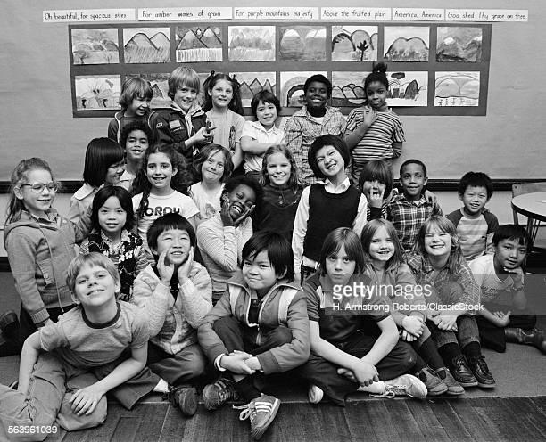 1980s GROUP PORTRAIT OF...