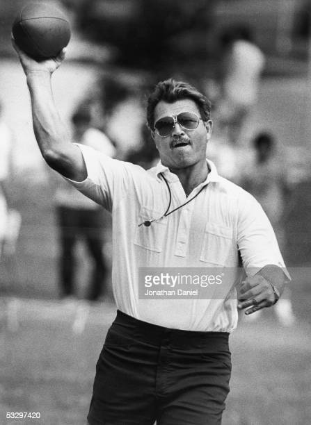 1980s: Head coach Mike Ditka of the Chicago Bears throws the ball during a circa 1980s Training Camp at the University of Wisconsin-Platteville in...