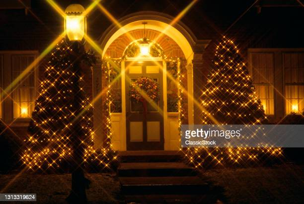 1980s House Doorway Decorated With Christmas Lights.