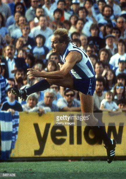 Malcolm Blight of the North Melbourne Kangaroos in action during a VFL match held at the Melbourne Cricket Ground 1980s in Melbourne Australia