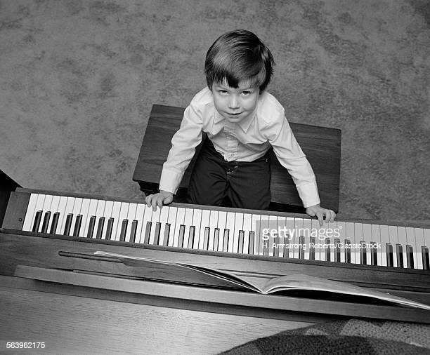1980s OVERHEAD OF BOY...