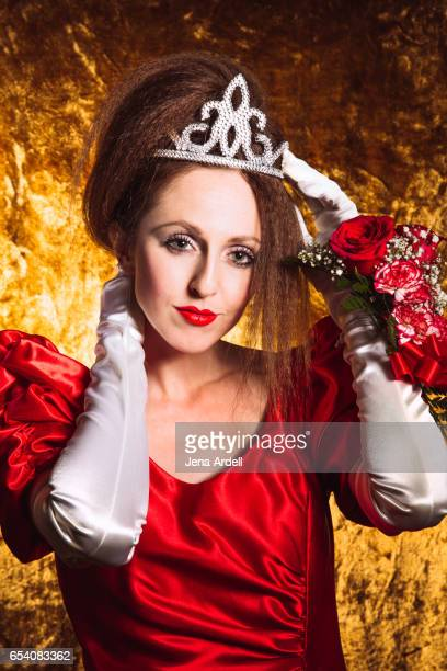 1980s prom queen wearing red dress - jena rose stockfoto's en -beelden