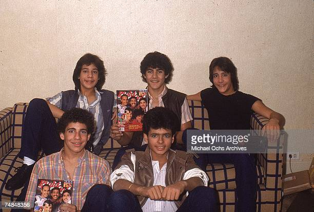 Puerto Rican teen quintet 'Menudo' pose holding Right On Magazines for a mid 1980's portrait Ricky Martin was a member from 19841989