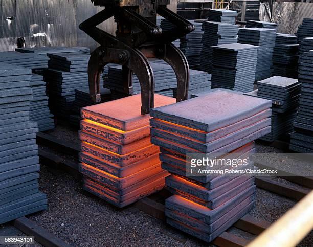 1980s STEEL MILL INTERIOR CRANE LIFTING HOT INGOTS OF GLOWING STEEL
