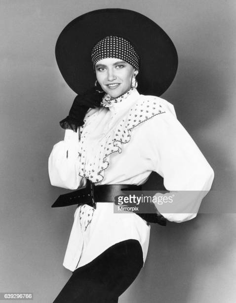 1980s Women's Fashion Our model wears White frill belted blouse black leggings gloves and wide brimmed hat 7th August 1989
