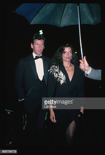 1982Fashion designer Calvin Klein and model Bianca Jagger are shown arriving at an unnamed function