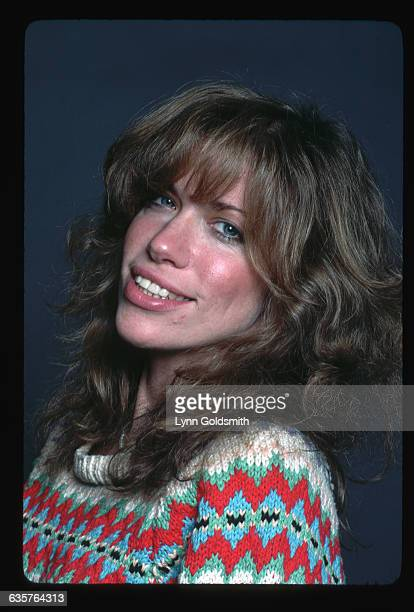 1982Singer/songwriter Carly Simon is shown in this headandshoulders studio portrait smiling She wears a multicolored patterened sweater