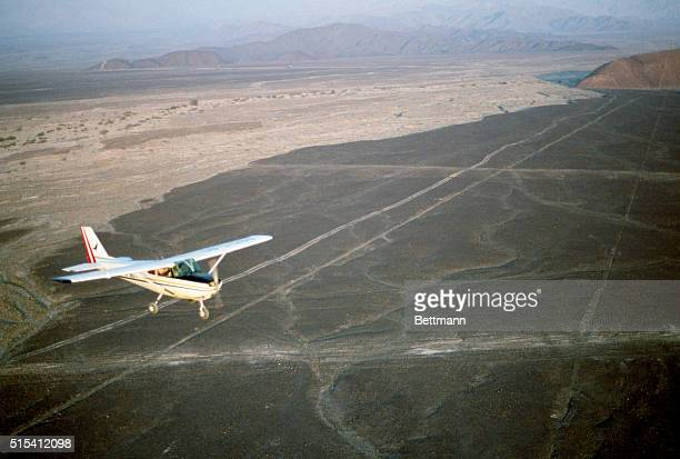 Tourists fly in a small plane over the Nazca Lines of Peru Slide shows an aerial view of the airplane with the Nazca Lines in the background