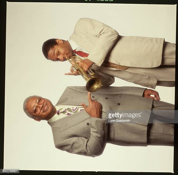 1983Portrait of father Ellis Marsalis pointing to his son Wynton playing trumpet