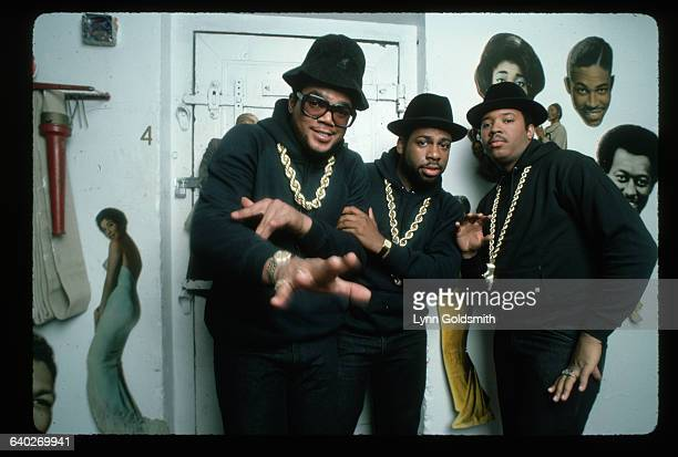 1987Rap group RunDMC are shown posed in a white room with what appears to be pictures of black entertainers on the wall Left to right DMC Run and Jam...