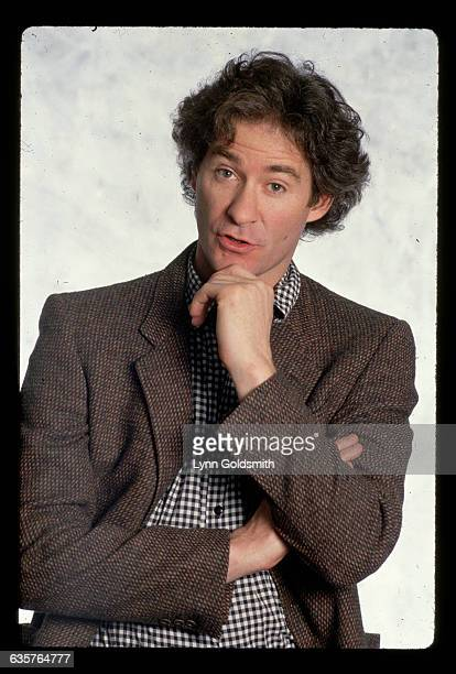 1988Actor Kevin Kline is shown in a waistup studio potrait with his hand under his chin in a gesture that looks as if he's about to ask a question