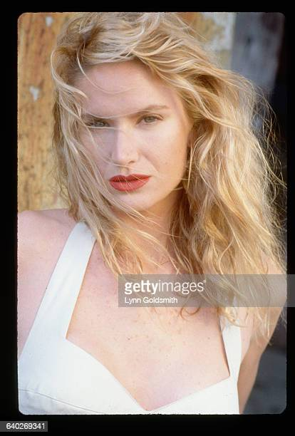 1988Actress Kelly Lynch is shown wearing a white dress in this head and shoulders portrait She is outdoors with the wind blowing her hair