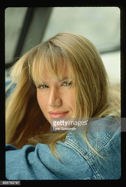 1988Photo shows actress Kelly Lynch apparently seated in a head and shoulders portrait She wears a denim shirt or jacket