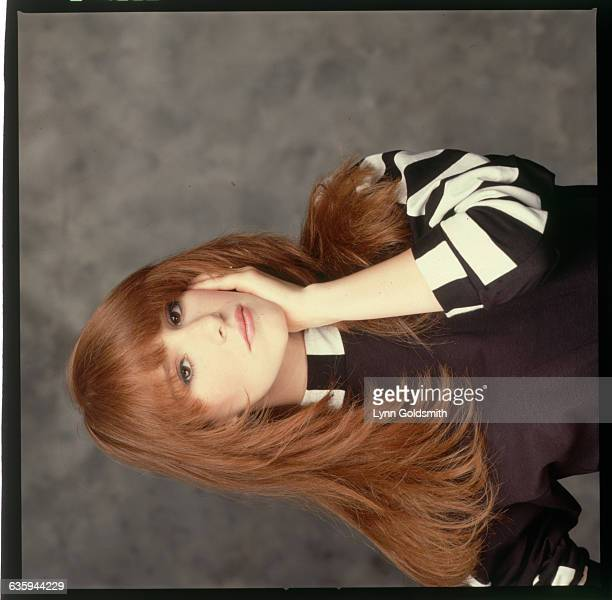 1988Pop singer Tiffany is shown in a studio closeup her hand by her face