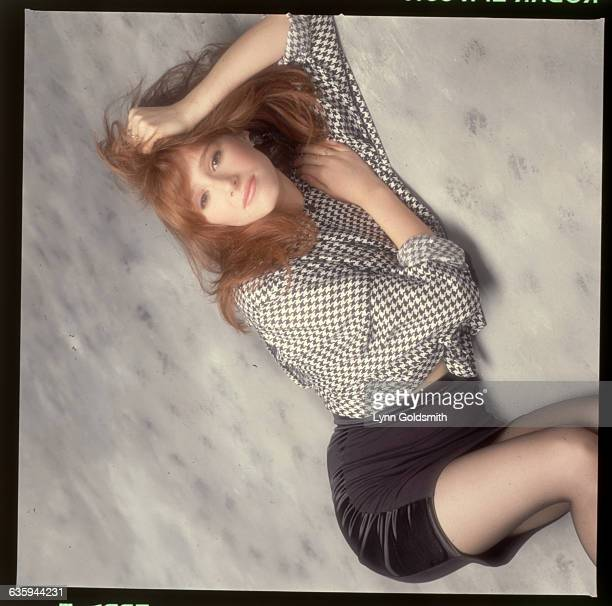 1988Pop singer Tiffany is shown lying on the floor of a studio Her head rests in her hand
