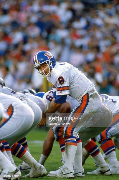 Gary Kubiak of the Denver Broncos takes the snap against the San Diego Chargers at Jack Murphy Stadium circa 1989 in San DiegoCalifornia on December...