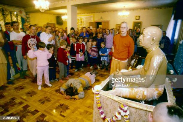 A meeting of followers of the hare krishna religious organisation a section of hinduism Pictured a statue of His Divine Grace A C Bhaktivedanta Swami...